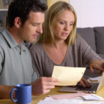 Couple reviewing home prices and housing market reports